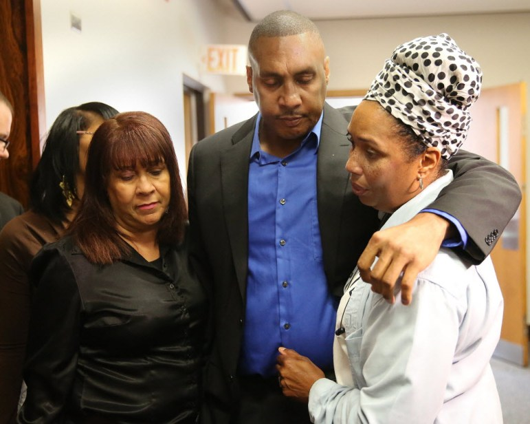 Claudiare Motley is surrounded by his sisters after the sentencing of Nathan King in July. Motley, who was shot in Milwaukee last year, has undergone multiple surgeries and faced tens of thousands of dollars in bills and lost wages. Motley was one of 583 victims of nonfatal shootings in Milwaukee in 2014.