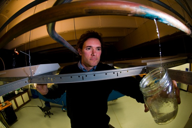 Marc Edwards, a Virginia Tech engineering professor who is a national expert on lead in drinking water, collects a sample from a leaking water pipe. Edwards' research has shown that existing federal requirements can increase rather than decrease the exposure of consumers to lead.