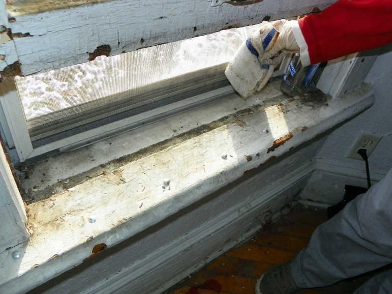 Old, peeling paint, seen in this windowsill in a rental property in Milwaukee, is often blamed for lead poisoning in children. But experts and advocates point out that lead from aging pipes also can make its way into drinking water, providing another avenue of lead exposure.