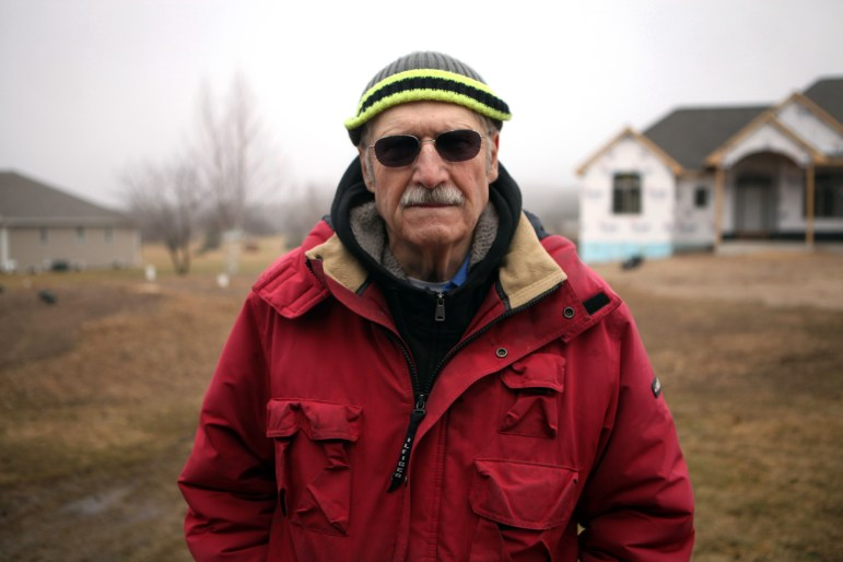 John Teichtler, Door County sanitarian, is seen near a property his office inspected during the construction of its septic mound system. The Door County Sanitarian Department was created in the mid-1960s by the county board because of concerns that failing private sewage disposal systems were contaminating drinking water. Teichtler has worked for the department since 1971.