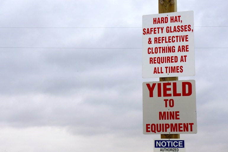 """Safety signs are seen outside a frac sand mine owned by Pattison Sand Co. in Bridgeport, Wis. The mine, whose status is currently listed as """"intermittent,"""" has received seven violations since it began operations in 2013."""