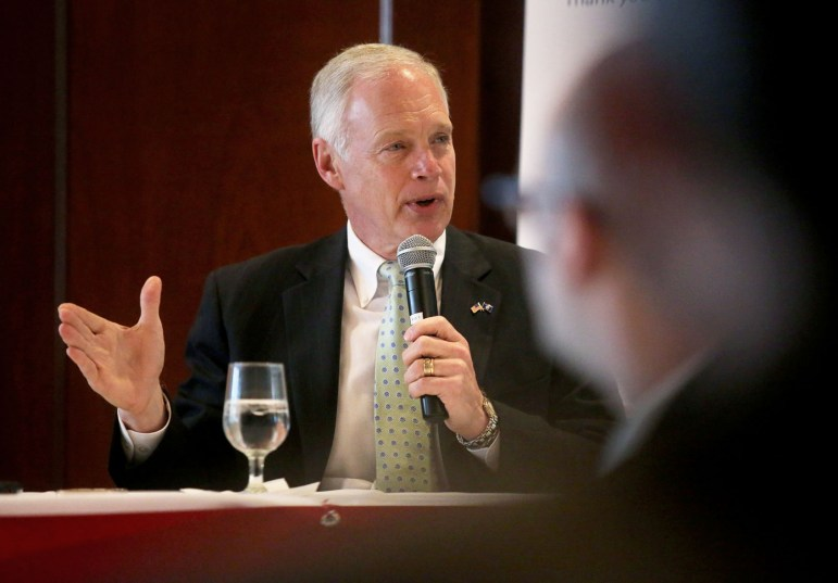 Republican Sen. Ron Johnson fields questions from attendees during a luncheon at The Madison Club in Madison on Oct. 9, 2015. Johnson is seeking re-election to the seat he won from Democrat Russ Feingold in 2010.