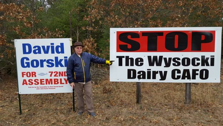 "David Gorski is running as a Democrat for the 72nd Assembly District. He is seen here with a sign opposing the Golden Sands Dairy, which has been proposed by the Wysocki Family of Cos., which also owns the Central Sands Dairy. On his Facebook page, Gorski said: ""We all want businesses to grow, but one business shouldn't be allowed to harm the health and property value of its neighbors."""
