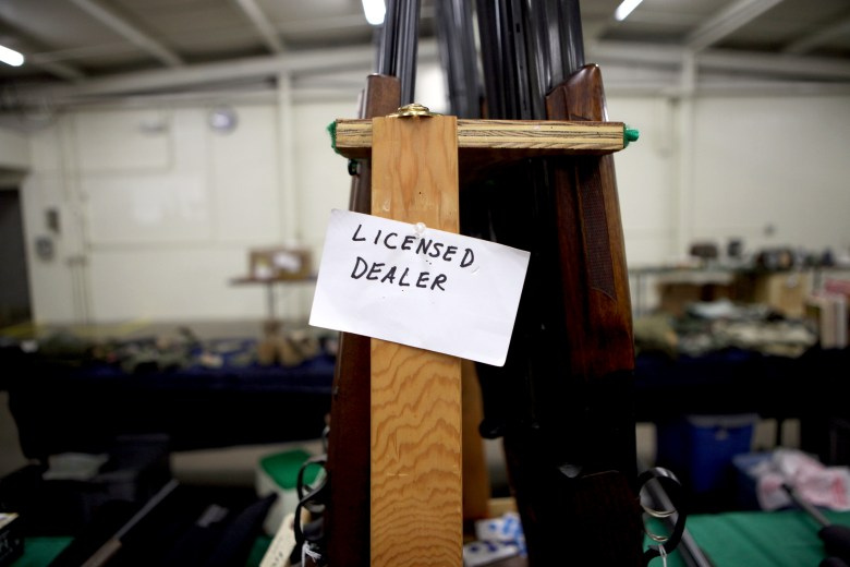 A tag at Ron Martin's booth at the Badger Military Collectible Show in Waukesha on Aug.5, clearly identifies him as a licensed gun dealer. Martin, who has been a licensed dealer for 33 years, runs background checks on any potential purchaser of his guns.