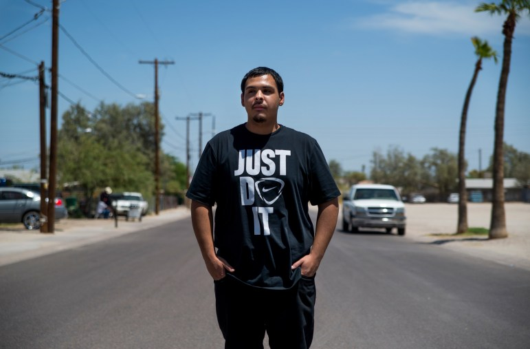 David Castorena, 24, of Chandler, Ariz., stands in the street of a small, largely-Latino community of Guadalupe where he attends church. Castorena said he does not plan to vote in the upcoming November Election because he thinks that Donald Trump will win either way.