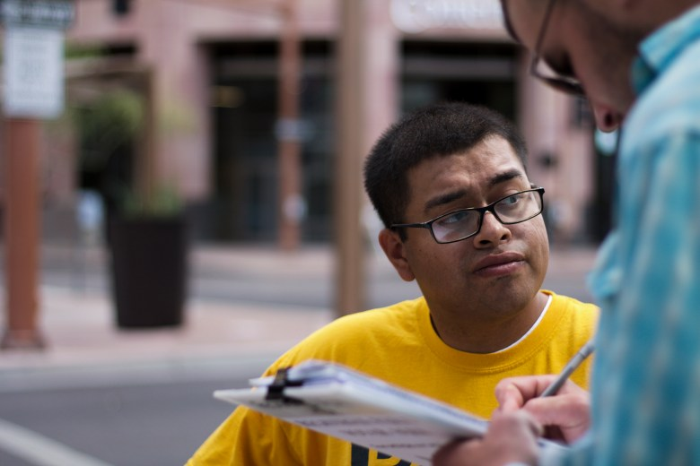 Jose Barboza, a Promise Arizona volunteer, registers voters in Phoenix. Thirteen cases of double voting were prosecuted in the state since 2012. But a News21 review of alleged voter fraud in key states since 2012 found no cases of voter impersonation, the type of fraud that voter ID is designed to combat.
