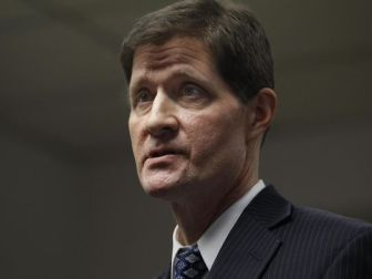 District Attorney John Chisholm aims to promote neighborhood development and strong families.