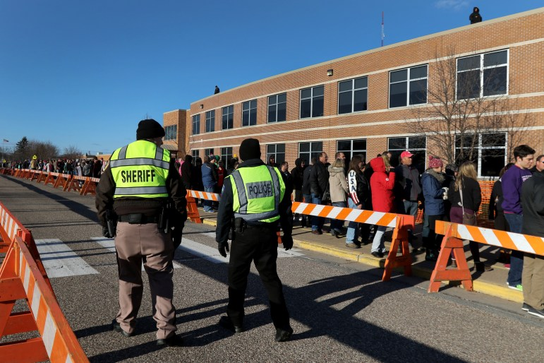 Eau Claire law enforcement monitor the crowd outside of Memorial High School as they wait to see Donald Trump speak April 2, 2016 in Eau Claire, Wis. Trump is among the candidates whose campaigns owe communities in Wisconsin thousands of dollars for police protection in 2016, according to an investigation by the Center for Public Integrity.