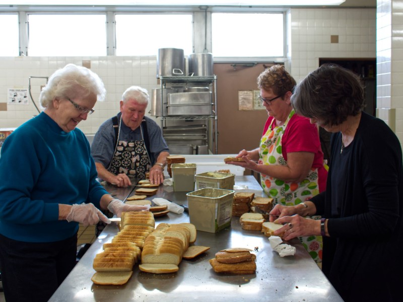 Volunteers prepare food at one of Capuchin Community Services' locations.