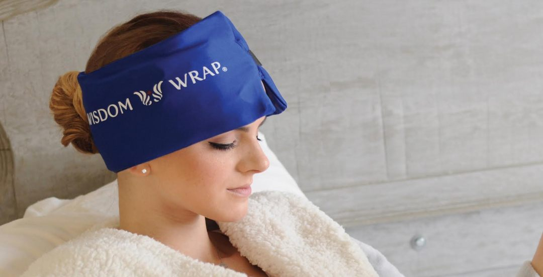 lady wearing ice pack for headaches