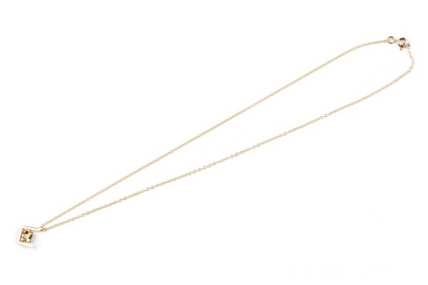 Earth pendant with yellow zircon set in yellow gold flatlay