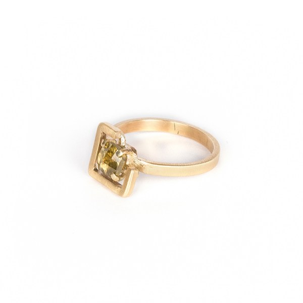 Earth ring greenish yellow zircon set in brushed yellow gold side view 1