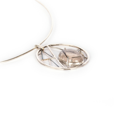 Tourmalinated quartz set in geometric sterling silver side view right