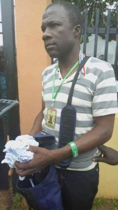 OSUN ELECTIONS: INEC Officer Caught Tearing Election Results (Photos)