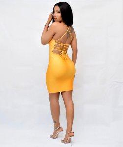 Mercy Eke in Yellow dress