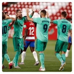 Karim Benzema celebrating goal with teammates in Granada vs Real Madrid game