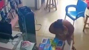 Moment A Lady Caught On Camera Stealing Phone From A Shop In Port-Harcourt (Video)
