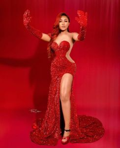 Erica Nlewedim in red dress and red background