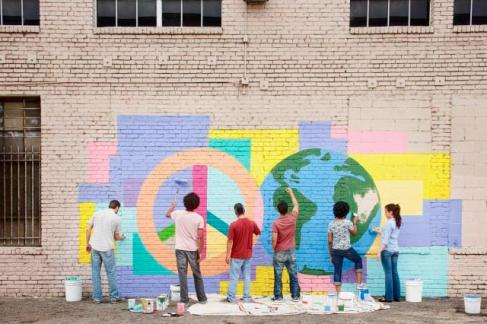 Community painting mural, Tim Pannell/Corbis