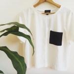 content creation minimalistic white top black pocket