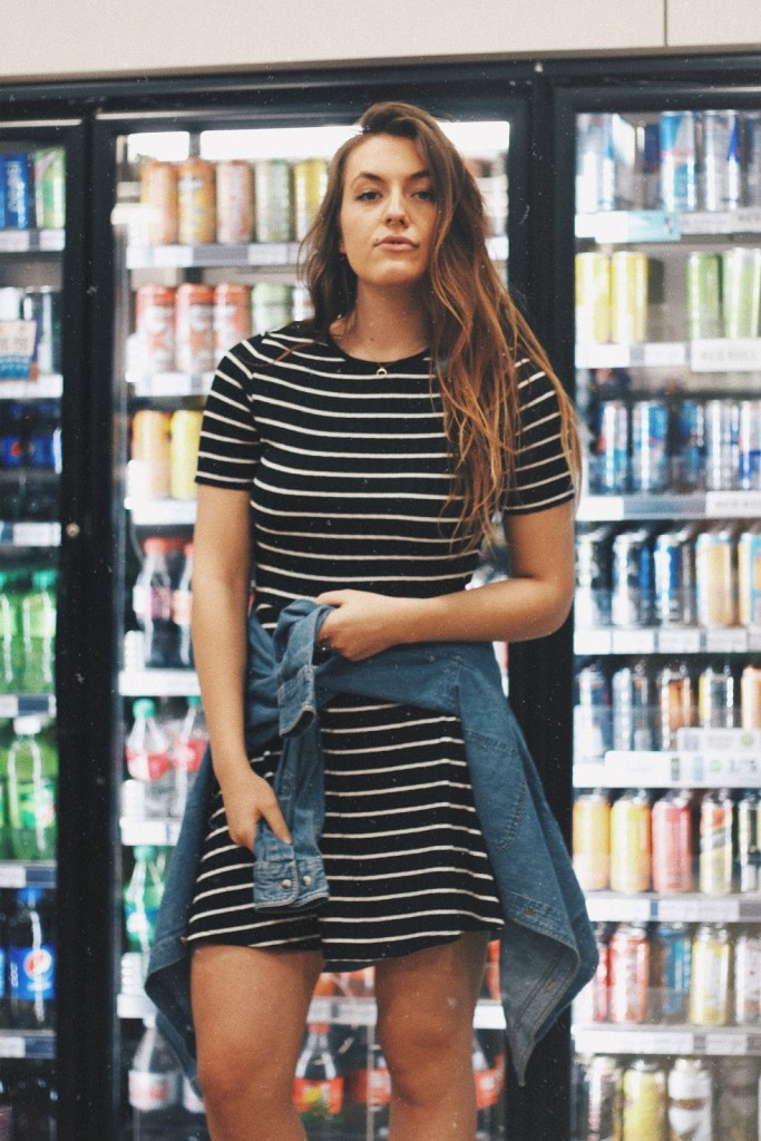 healthy gas station girl in gas station striped dress moody portrait