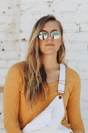 last thing you should be doing reflective sunglasses portrait white overalls