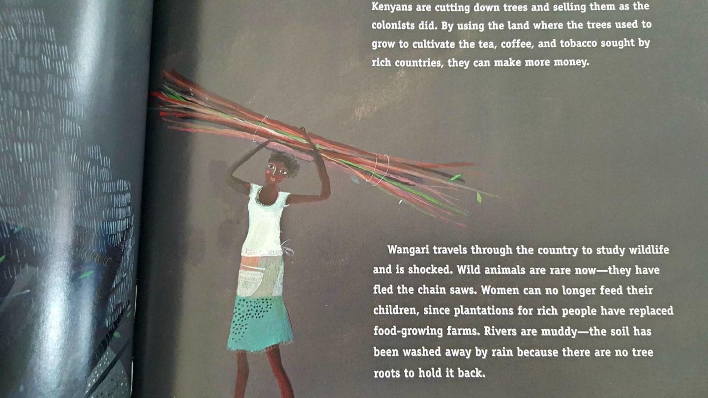 African woman carrying bundles of sticks