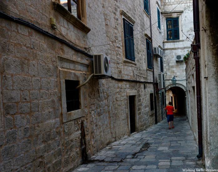 A lone woman walking down an alleyway Dubrovnik