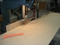 Using a band saw to rip the individual layers of bending board