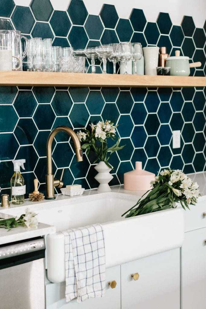 Hexagon Tiles Teal Honeycomb Tile Backsplash with White Grout in Kitchen Farmhouse Sink Copper Fixtures