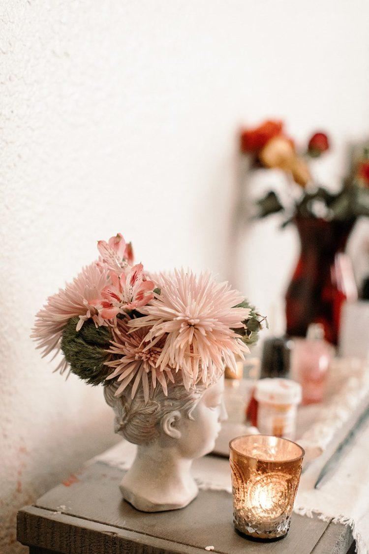 flowers in a ceramic head vase studio apartment wit & delight