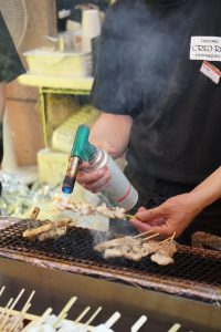 picture of yakitori being cooked at dontonbori osaka