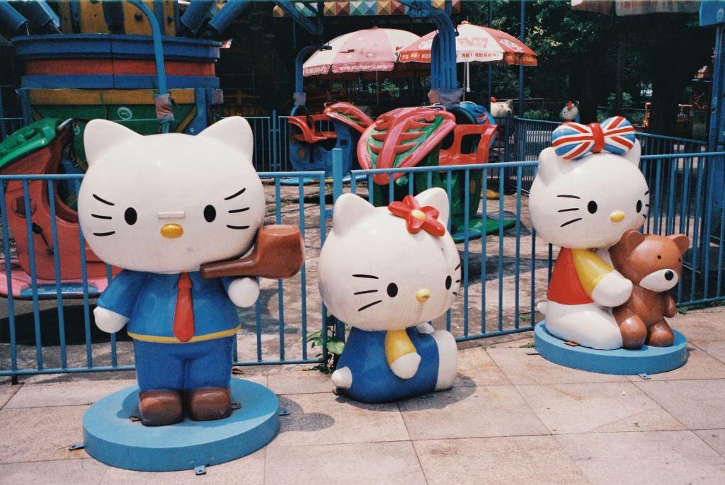 three hello kitty statues