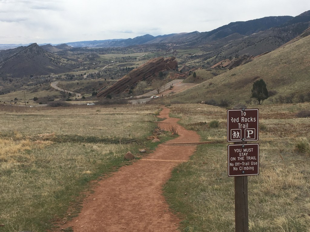 Photo of a winding path in the middle of Red Rocks scenery in Denver, Colorado