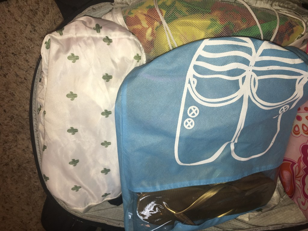 Some of my holy grail, favorite products to make packing light easier for carry-on travel: Packing cubes and travel shoe bags!
