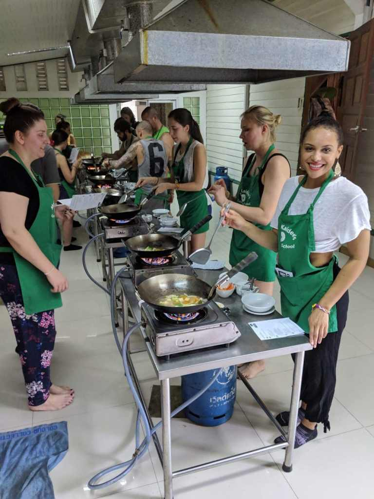 Making Tom Yum Soup at May Kaidee cooking school in Bangkok, Thailand.