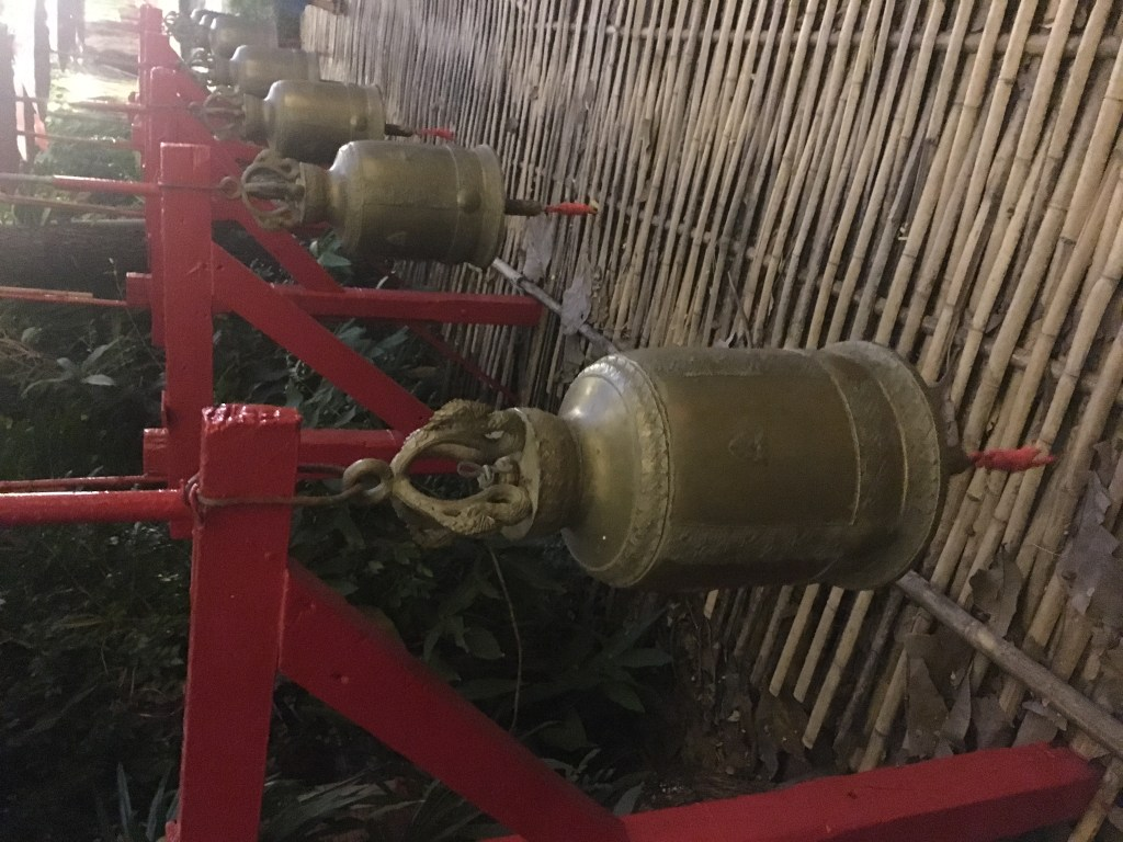 Photo of temple bells at sunset Wat Phan Tao in Chiang Mai, Thailand