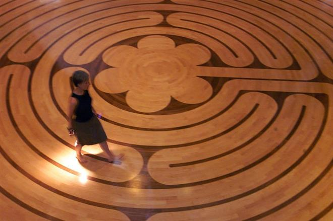 woman walking at St Paul's Labyrinth in Vancouver