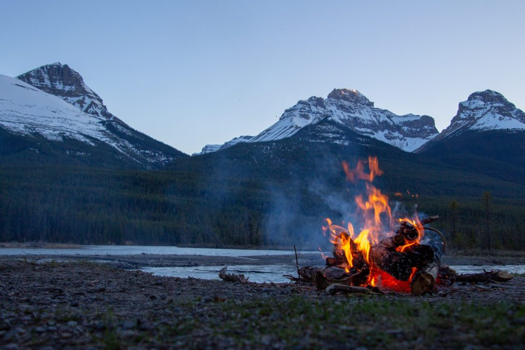 Bonfire by cold mountains and water