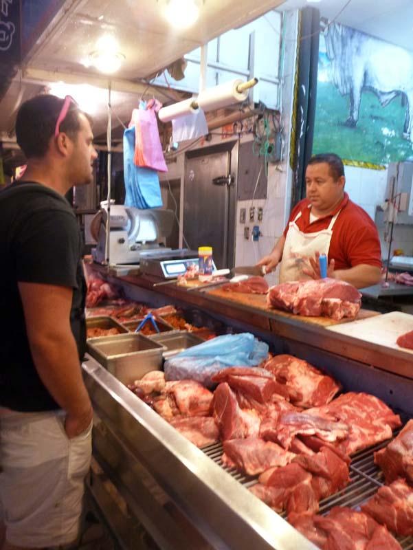 Jon trying to buy meat at the Mazatlan Meat Market - El Centro Mercado