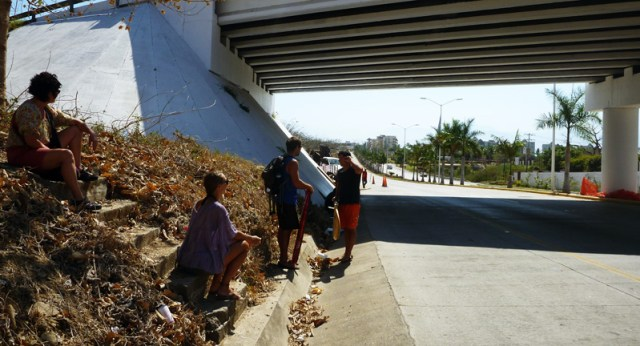 Waiting for the bus on the highway with our surfboard in Puerto Vallarta