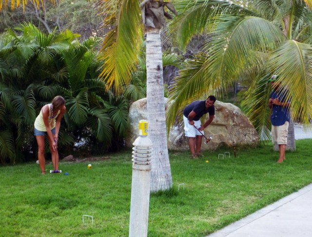 Lining up a shot - croquet in the marina