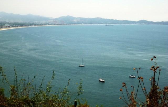 3 blue boats at anchor
