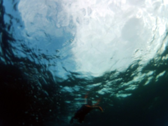 Clear water with a swimmer at the bottom