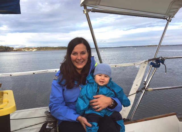 Mommy and Zephyr in the cockpit with the weathercloths (strataglass) and bimini (stamoid)