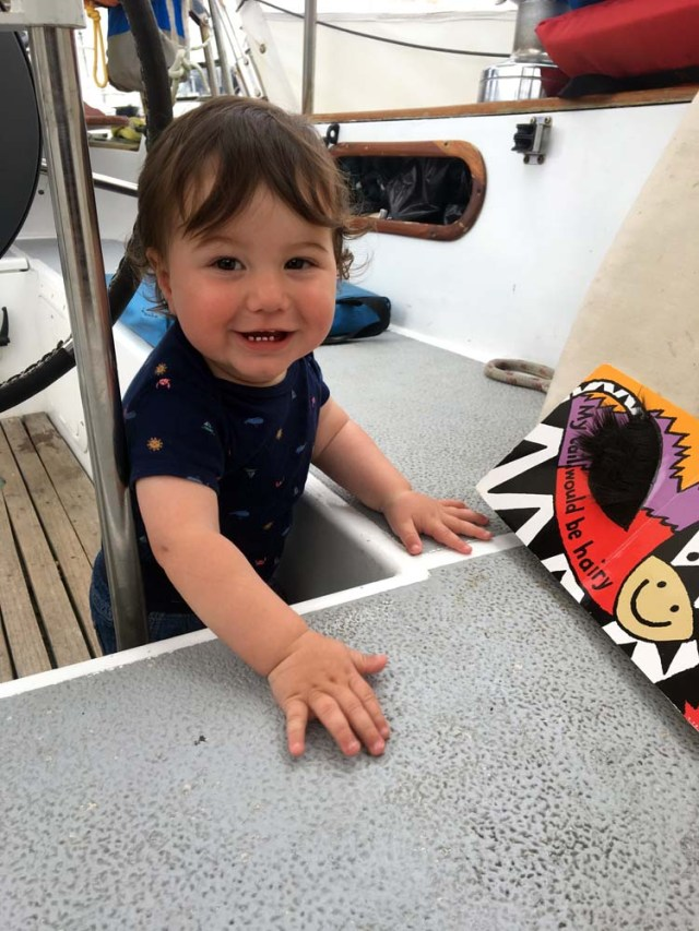 Boat baby playing in the cockpit