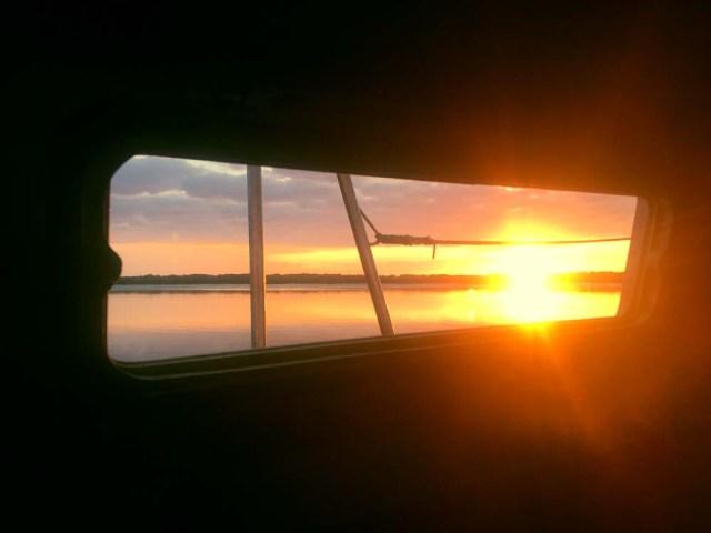 Sunrise out the porthole on NorWest 33