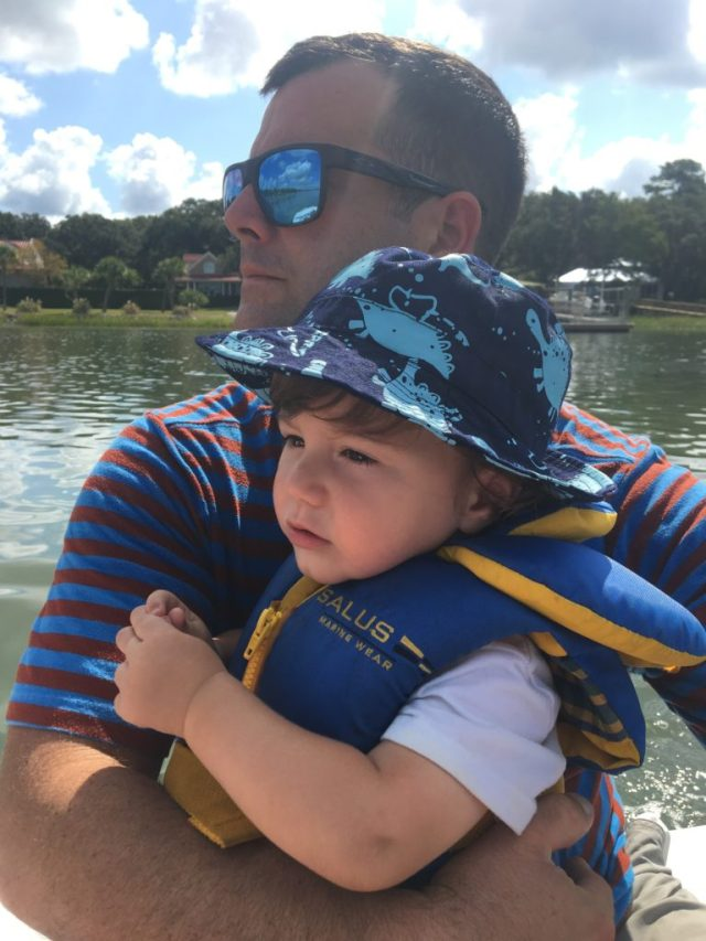 Toddler and daddy in dinghy in Beaufort, SC near Lady's Island Marina