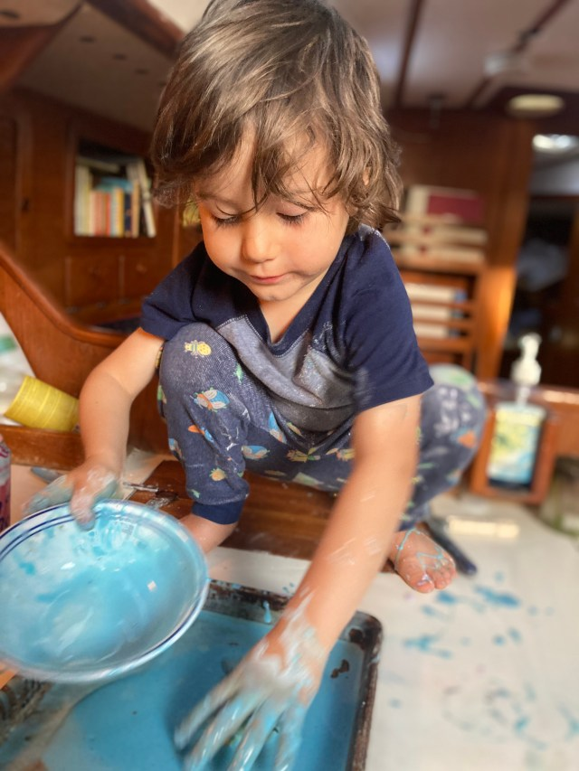 Toddler on a Sabre 42 sailboat making a fun mess in the galley