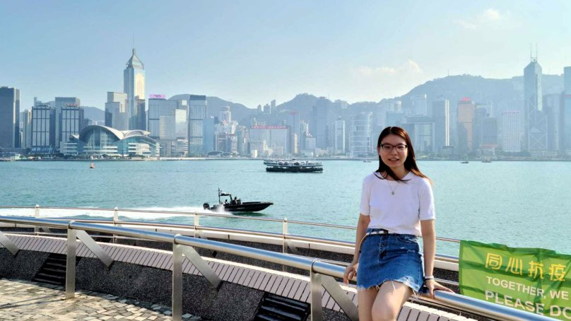 Elizabeth Ng standing in front of Hong Kong harbour.
